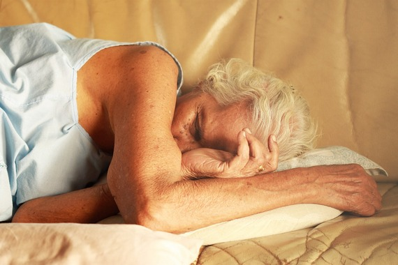 An elderly woman fallen asleep