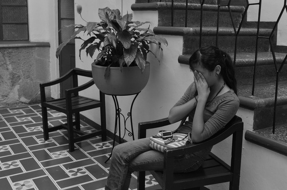 Woman feeling anxious, in black-and-white