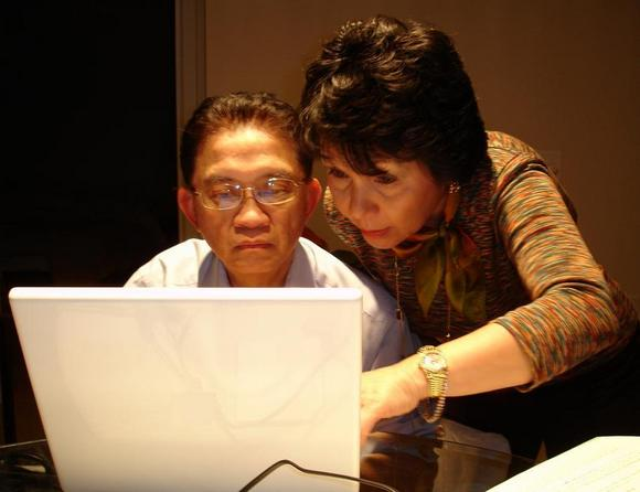 Parents seeking online on a laptop