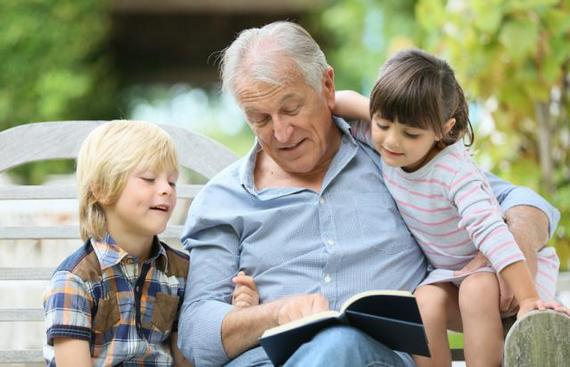 Reading a book to grandchildren